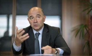 Le commissaire aux Affaires économiques, Pierre Moscovici, lors d'une interview à l'AFP le 5 novembre 2014 à Bruxelles