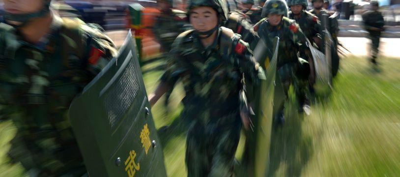 Des membres d'une «force antiterroriste» chinoise au Xinjiang, en 2013.