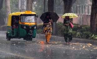 A New Delhi, des trombes d'eau rendent les déplacements difficiles mercredi 19 mai 2021.