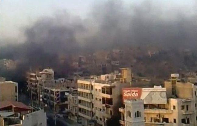 Vue d'immeubles d'où s'échappe de la fumée, à Hama, en Syrie, tirée d'une vidéo postée sur Internet le 31 juillet 2011.