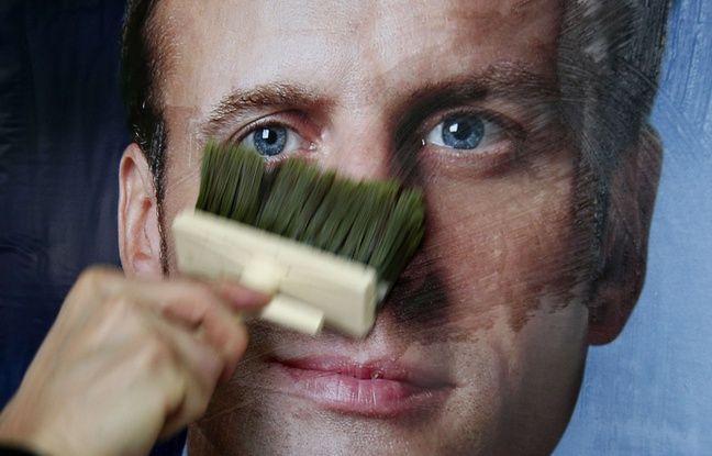 EN DIRECT. Présidentielle: A son arrivée à Albi, Macron vivement chahuté par des opposants à la loi Travail.. dans actualitas fr 648x415_une-affiche-de-campagne-d-emmanuel-macron-ap-photo-michel-spingler