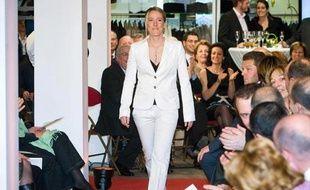 Justine Hénin a défilé pour la collection du couturier Carlo & Fils, le 19 mars 2009.