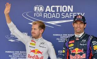 L'Allemand Sebastian Vettel et son coéquipier chez Redbull MarkWebber, le 12octobre 2013 àSuzuka.