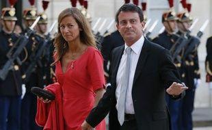 Le ministre de l'Intérieur Manuel Valls et son épouse Anne Gravoin au palais de l'Elysée le 3 septembre 2013