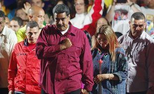 Nicolas Maduro avec son épouse Cilia Flores après l'annonce des résultats, à Caracas le 20 mai 2018.