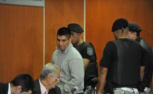Gustavo Lasi (c), mis en cause dans le procès visant à élucider le meurtre de deux Françaises en Argentine en 2011, au tribunal de Salta le 25 mars 2014