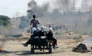Scène d'affrontement entre Gazaouis et force de sécurité israéliennes au point de passage de Nahal Oz, le 10 octobre 2015