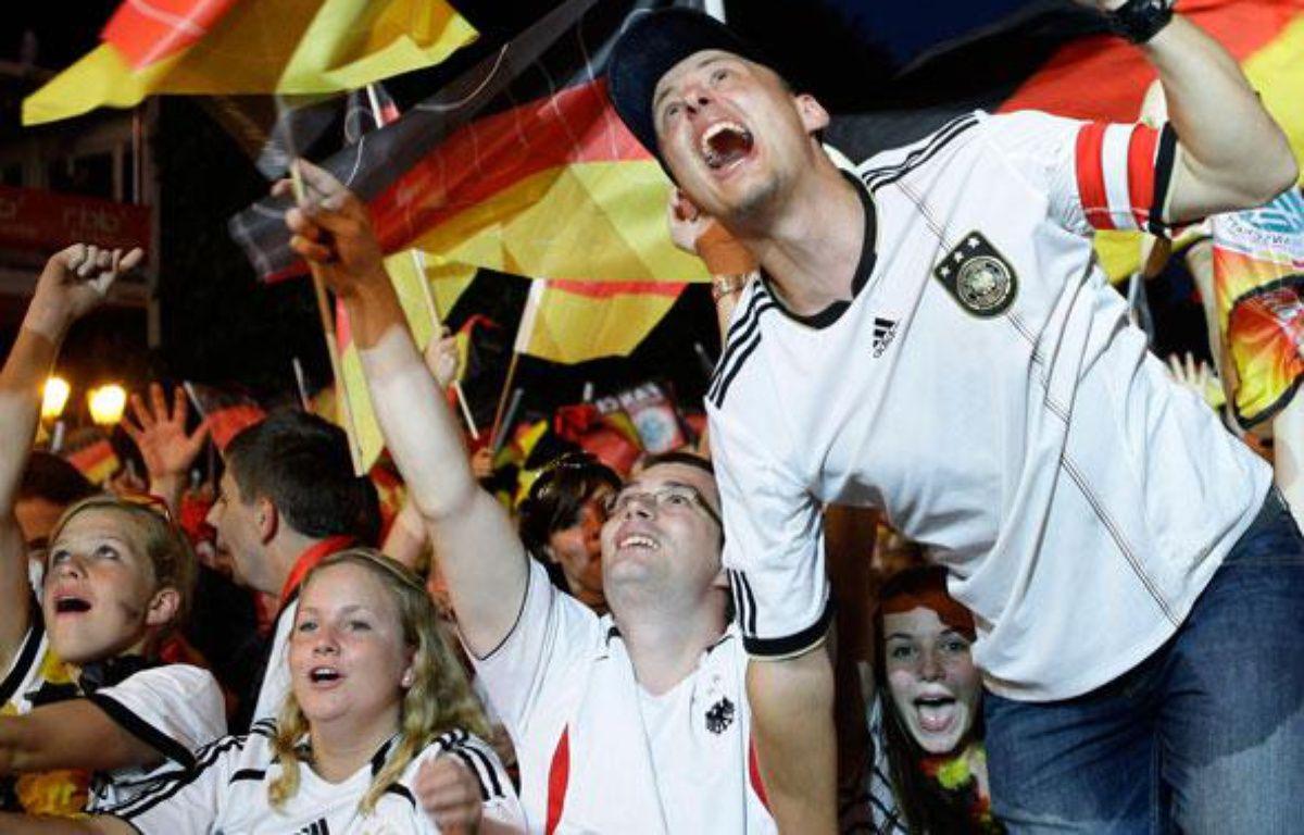 Rendez-vous en 2012, 2014, 2016, 2018, 2020, etc, etc, etc.Les supporters allemands à Port-Elisabeth, le 10 juillet 2010. – Reuters