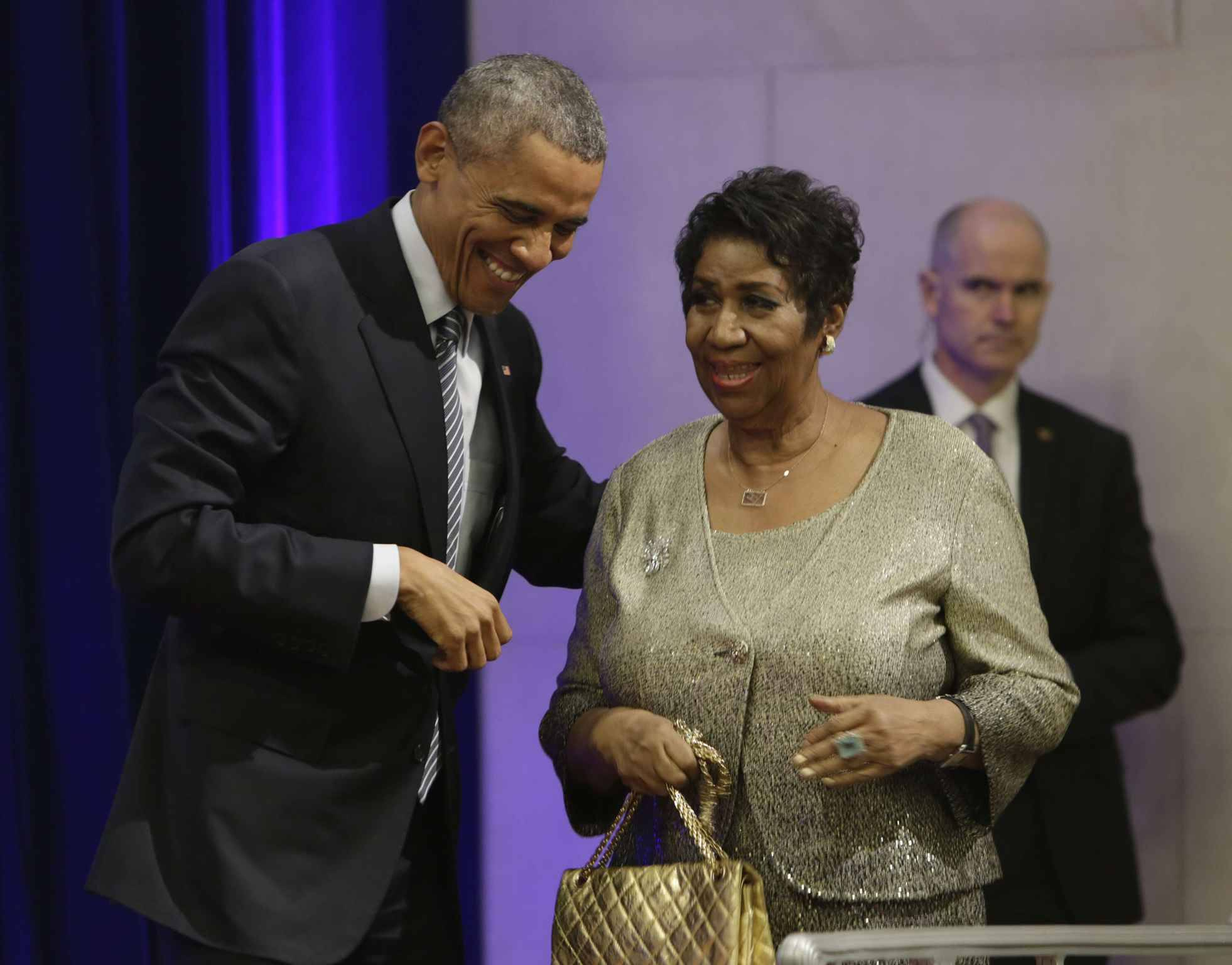 U.S. President Barack Obama welcomes Aretha Franklin as she arrives to sing at the portrait unveiling ceremony for outgoing U.S. Attorney General Eric Holder at The Department of Justice in Washington, DC, February 27, 2015. Photo by Chris Kleponis/Pool *** Please Use Credit from Credit Field ***/sipausa.sipausa_14909558/1502281519