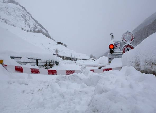 A closed road leading to Traesch is pictured in Zermatt, Switzerland, Sunday, Jan. 21 2018. Due to heavy snowfall, Zermatt can only be reached by air. Swiss authorities have closed roads and train service into the town of Zermatt amid a heightened risk of avalanches. (Philippe Mooser/Keystone via AP)/ZER101/18021448501400/1801211413