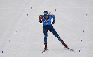 Adrien Backscheider, dernier relayeur de la France pour aller chercher la médaille de bronze lors du relais de ski de fond aux JO de Pyeongchang, le 18 février 2018.