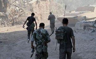 Des soldats syriens se déploient dans la ville de Jobar le samedi 24 août 2013.