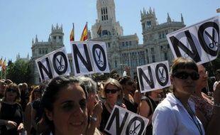 En Espagne, des manifestants se préparaient samedi au dernier rassemblement en date contre les coupes budgétaires annoncées par le gouvernement, alors que l'inquiétude monte concernant la stabilité financière du pays et la survie de l'euro.