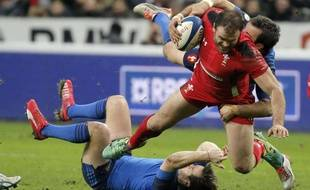 Walesí Jamie Roberts is tackled by Franceís Morgan Parra during their Six Nations tournament match at Stade de France, in Saint Denis, north of Paris, France, Saturday, Feb. 28, 2015. (AP Photo/Francois Mori)/XFM108/598497525665/1502281922