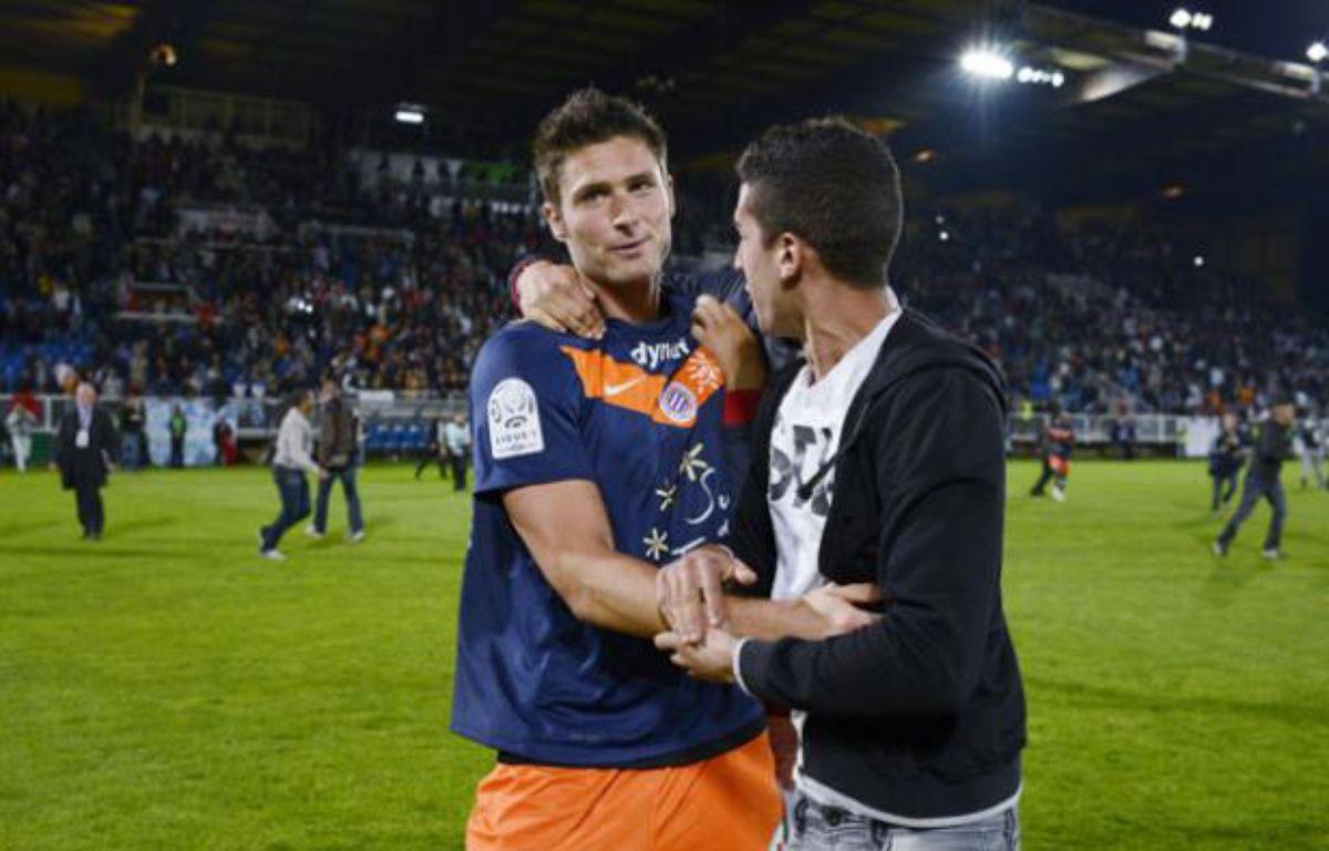 Olivier Giroud à l'issue du match contre Auxerre qui a sacré le club Montpellierain champion de France le 20 mai 2012. – JEFF PACHOUD / AFP