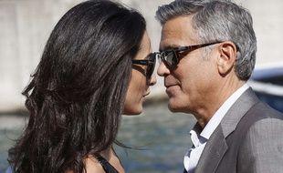 George Clooney et Amal Alamuddin arrivent à Venise pour leur mariage, le 26 septembre 2014.