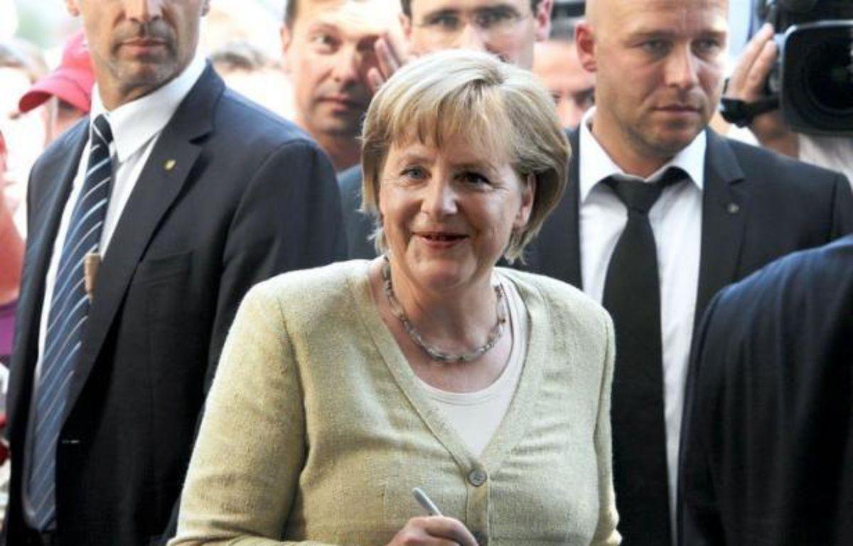 La chancelière allemande Angela Merkel est encore cette année la femme la plus puissante du monde, devant la secrétaire d'Etat américaine Hillary Clinton et la présidente brésilienne Dilma Rousseff, selon le classement annuel du magazine Forbes publié mercredi. – Britta Pedersen afp.com