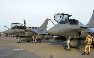 This Sunday Jan.13, 2013 photo provided by the French Army Monday Jan.14, 2013 shows French Rafale jetfighters on the tarmac after a mission to Mali in N'Djamena, Chad. French fighter jets bombed rebel targets in a major city in Mali's north Sunday, pounding the airport as well as training camps, warehouses and buildings used by the al-Qaida-linked Islamists controlling the area, officials and residents said. (AP Photo/Adj Nicolas-Nelson Richard, ECPAD)/