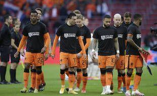 Les joueurs des Pays-Bas ont porté un maillot avec l'inscription «le football pour le CHANGEMENT» avant leur match de qualification à la Coupe du monde 2022 au Qatar, le 27 mars 2021.