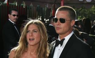 19 September 2004 - Los Angeles, California - Jennifer Aniston and Brad Pitt. The 56th Annual Primetime Emmy Awards held at the Shrine Auditorium. Photo Credit: Jean Catuffe/Sipa Press/emmyarriv.251/0409200850
