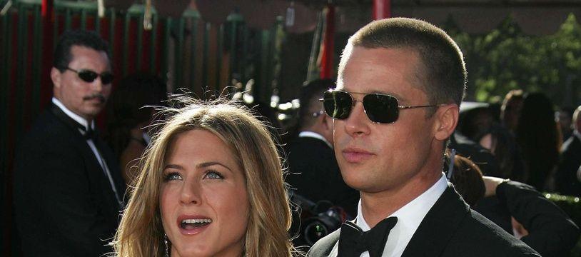 19 September 2004 - Los Angeles, California - Jennifer Aniston and Brad Pitt. The 56th Annual Primetime Emmy Awards held at the Shrine Auditorium. Photo Credit: Jean Catuffe/Sipa Press/emmyarriv.251/0409200850