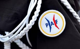 Le logo de la Police aux frontières (PAF) sur un uniforme