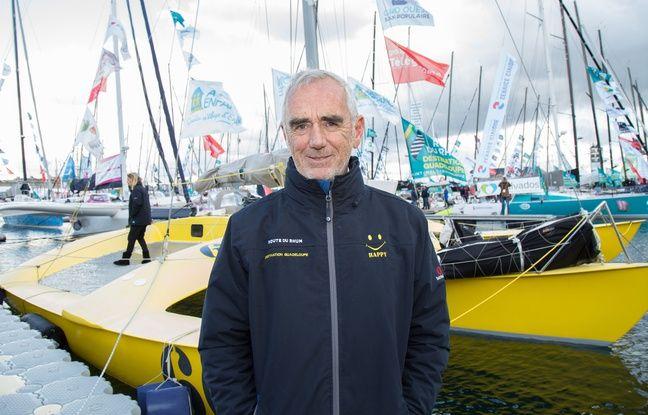 Loïck Peyron, ici devant Happy, le trimaran avec lequel il va prendre le départ de la Route du Rhum. Il s'agit d'une réplique du bateau Olympus Photo avec lequel Mike Birch a gagné la première édition en 1978.