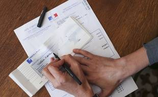 Illustration d'un paiement par chèque.