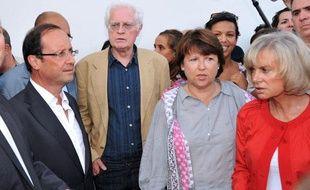 De gauche à droite: Les socialistes François Hollande, Lionel Jospin, Martine Aubry et Elisabeth Guigou, réunis à La Rochelle à la veille du début des journées d'été du PS, jeudi 25 août 2011
