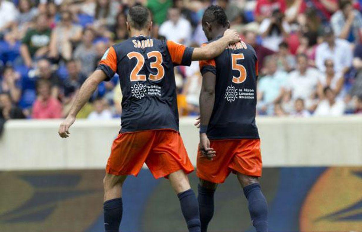 Les Montpelliérais Saihi et Bedimo lors du trophée des champions, le 28 juillet 2012 – DON EMMERT/AFP