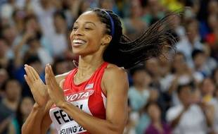 United States' Allyson Felix celebrates after winning the gold medal in the women's 400m final at the World Athletics Championships at the Bird's Nest stadium in Beijing, Thursday, Aug. 27, 2015.  (AP Photo/Lee Jin-man) /WTC293/594268776311/1508271602