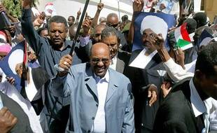 Sudanese President Omar al-Beshir attends a mass demonstration in Khartoum on March 5, 2009, in protest at the international arrest warrant issued against him for alleged war crimes in Darfur. Beshir, the first sitting head of state to be issued a warrant, dismissed the warrant and told the thousands of protestors that Western leaders were the real criminals. AFP PHOTO/ASHRAF SHAZLY