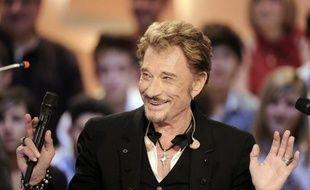 """Johnny Hallyday reste """"très ami"""" avec le président sortant Nicolas Sarkozy, mais """"souhaite bonne chance"""" à son successeur François Hollande """"car il va avoir du boulot"""", indique-t-il lundi alors qu'il entame lundi sa 181e tournée avec un concert à Montpellier."""