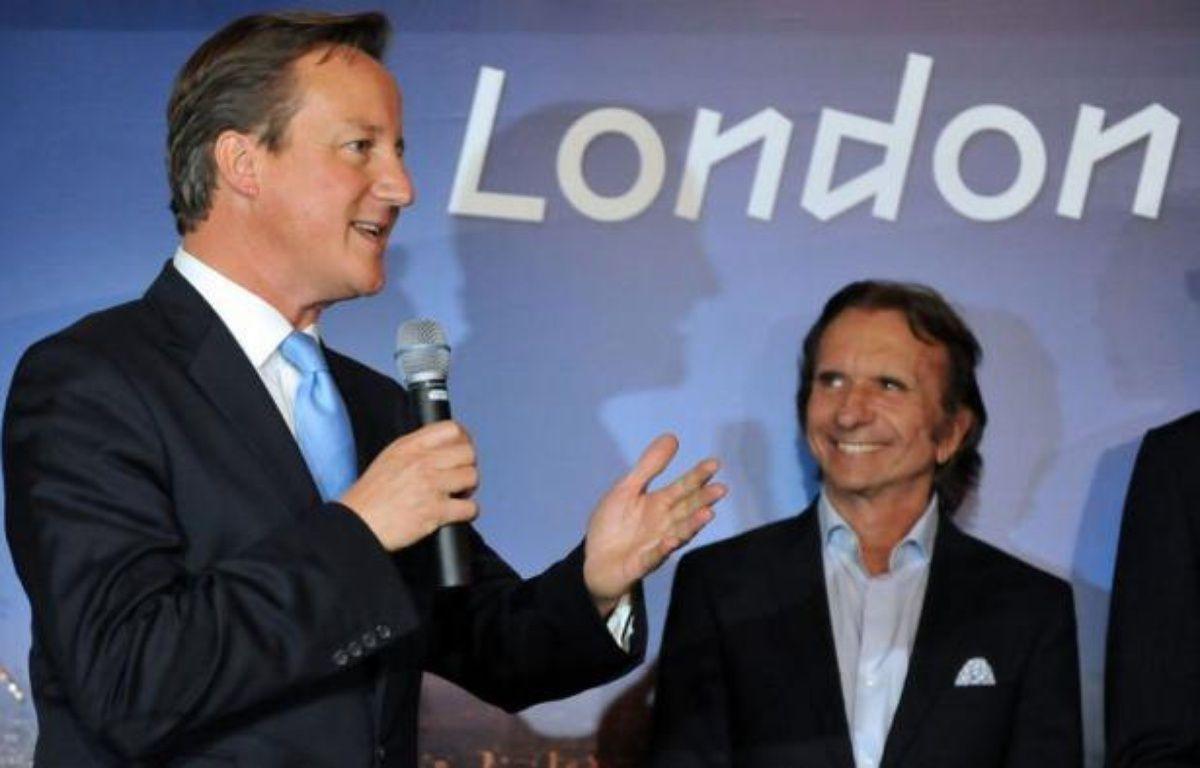 Le premier ministre britannique, David Cameron, a remis jeudi à la ville de Rio de Janeiro l'organisation du prix Laureus pour 2013 et 2014, qui récompense chaque année les meilleurs sportifs du monde, lors d'une cérémonie au Palais municipal. – Vanderlei Almeida afp.com