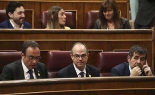 Trois députés catalans concernés par cette suspension : Josep Rull, Jordi Turull et Jordi Sanchez, le 21 mai 2019.