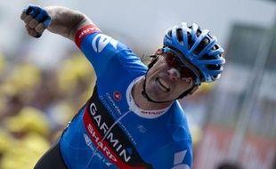 """Le Britannique David Millar (Garmin), qui revendique son étiquette de """"repenti"""" du cyclisme, a remporté la 12e étape du Tour de France, vendredi, à Annonay, où le Britannique Bradley Wiggins (Sky) a conservé son maillot jaune de leader"""