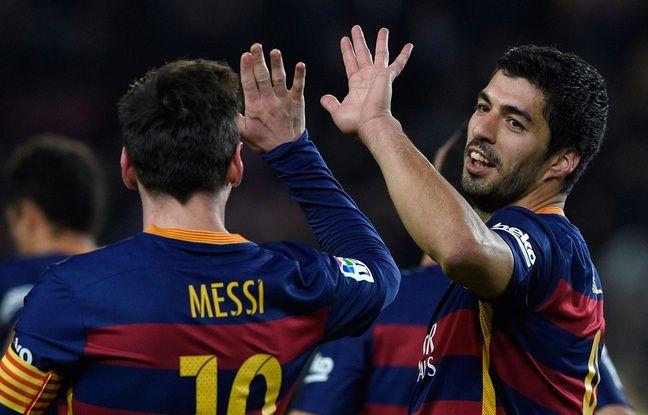Luis Suarez et Lionel Messi se félicitent après un but contre Valence le 3 février 2016.