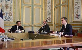 Emmanuel Macron, Edouard Philippe et Olivier Véran à l'Elysée, le 24 mars 2020.