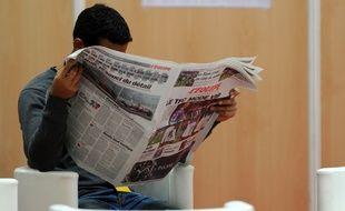 Un lecteur du journal «L'Equipe».