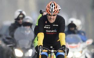 Le secrétaire d'Etat John Kerry lors d'une promenade à vélo le 16 mars 2015 à Lausanne, pendant une pause dans les discussions sur le nucléaire iranien