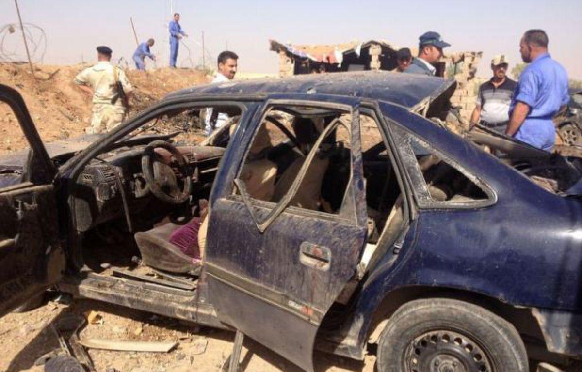 Au moins 32 personnes ont péri dimanche en Irak et près de 90 autres ont été blessés lors d'une série d'attentats, au cours de laquelle une bombe à proximité du consulat honoraire de France à Nassiriya, au sud de Bagdad, a fait un mort. – Marwan Ibrahim afp.com