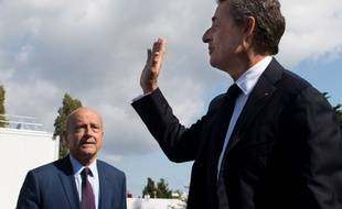 Alain Juppé et Nicolas Sarkozy à l'université d'été du parti Les Républicains à La Baule, le 5 septembre 2015.SALOM-GOMIS SEBASTIEN/SIPA