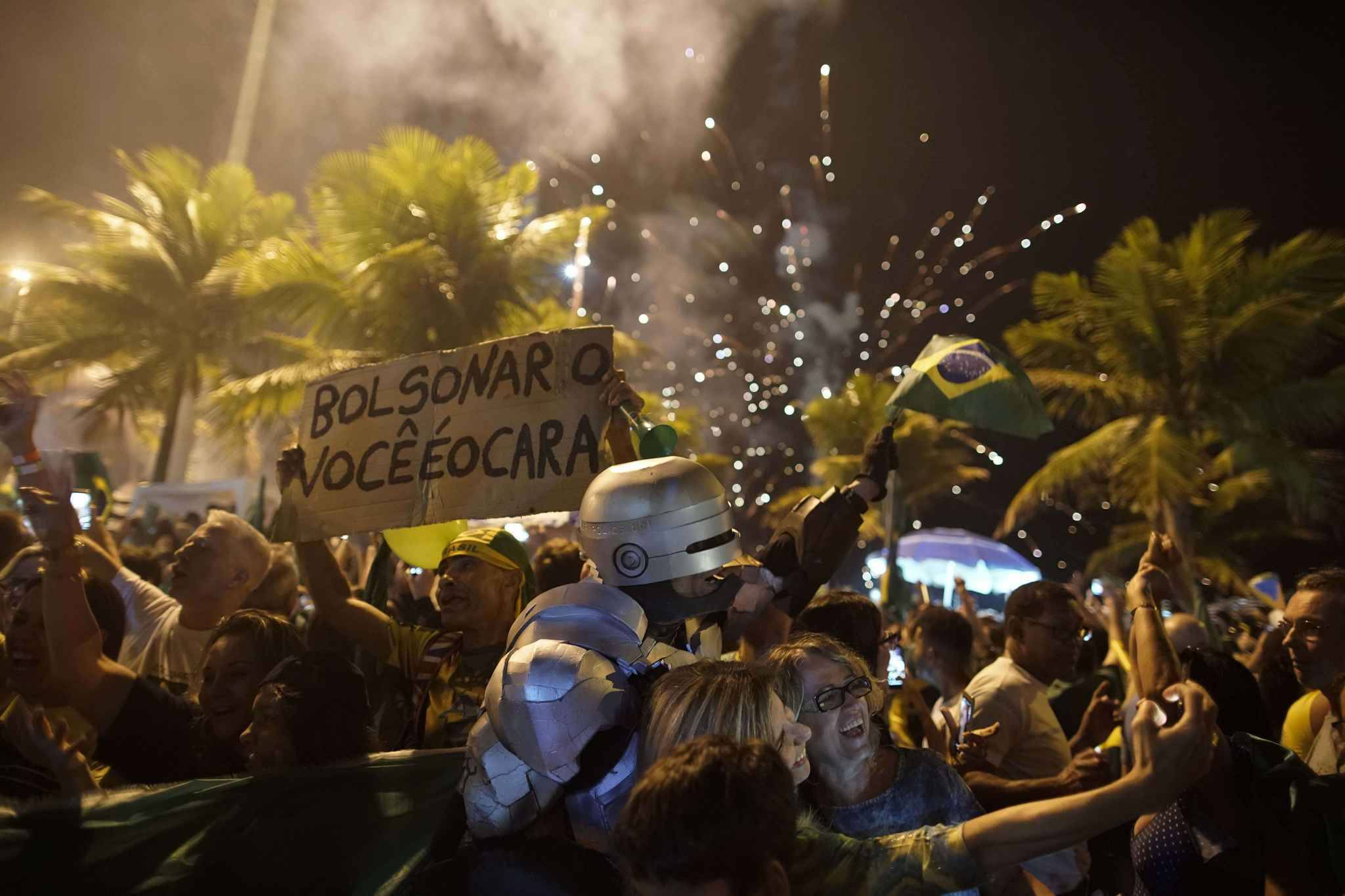 Supporters of Jair Bolsonaro celebrate in front of his residence in Rio de Janeiro, Brazil, Sunday, Oct. 28, 2018, after he was declared the winner of the runoff election . Brazil's Supreme Electoral Tribunal declared the far-right congressman the next president of Latin America's biggest country.