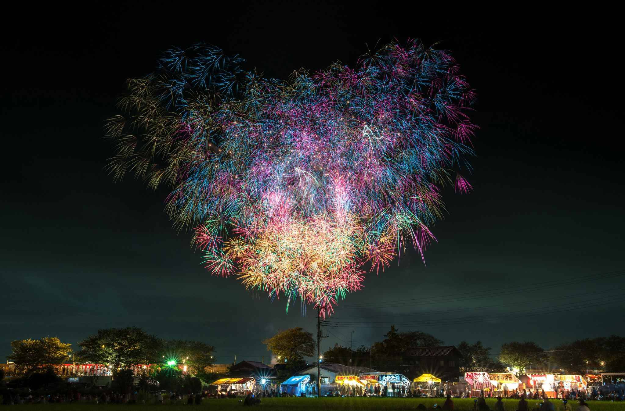 PIC BY MAKOTO IGARI / CATERS - (Pictured: Tsuchiura National Fireworks Competition, Tsuchiura City, Ibaraki Prefecture) - This incredible kaleidoscopic images showcase the sheer beauty of the mammoth firework displays that take place across Japan every summer. Photographer Makoto Igari has spent the last three years diligently pursuing such firework festivals across his homeland, with the Japanese themselves calling fireworks hanabi, meaning fire flower. Included in 32-year-old Makotos works were the likes of rainbow-coloured bursts, exploding over vast crowds; displays bright enough to illuminate the cities below; and works of incredible symmetry. Each year, local governments in Japan throw around 7,000 festivals, called Hanabi Taikai.