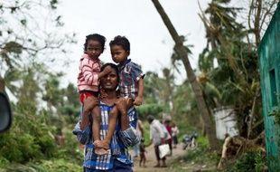 Le cyclone Phailin, le plus violent à frapper l'Inde depuis 14 ans, a fait au moins 14 morts selon un bilan provisoire publié dimanche, sans doute limité par le vaste mouvement d'évacuation de plus d'un million de personnes avant l'arrivée de la tempête.