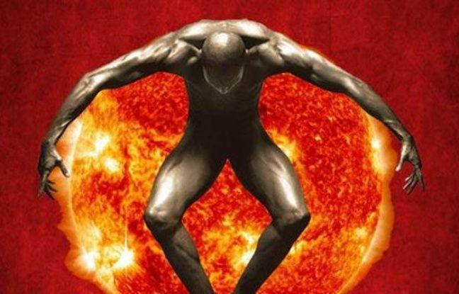 Affiche du spectacle du Feu d'Anatolie, représentant un homme enlaçant une planète en feu