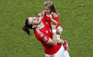 Wales' Gareth Bale celebrates with his daughter Alba after the Euro 2016 round of 16 soccer match between Wales and Northern Ireland, at the Parc des Princes stadium in Paris, Saturday, June 25, 2016. Wales won 1-0. (AP Photo/Francois Mori) /XFM9448/884200981208/1606252302