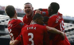 Wayne Rooney et ses partenaires lors de la victoire de Manchester United face à Bolton
