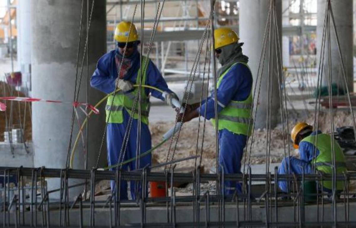 Des ouvriers sur un chantier à Doha au Qatar, le 3 octobre 2013 – Karim Jaafar Al Watan-Doha