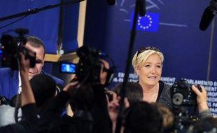Marine Le Pen arrive au Parlement européen à Bruxelles pour une conférence de presse, le 28 mai 2014